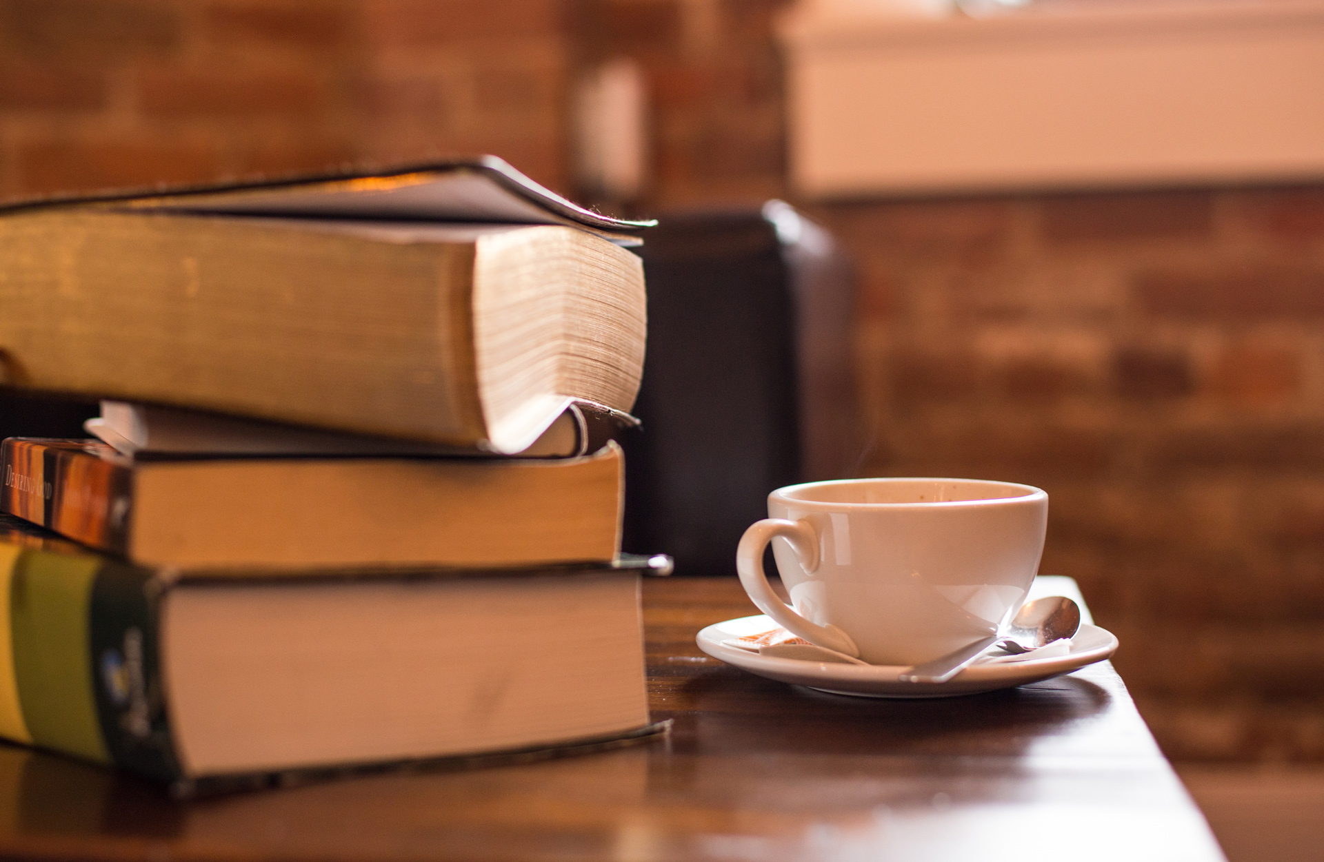 books on table with coffee mug