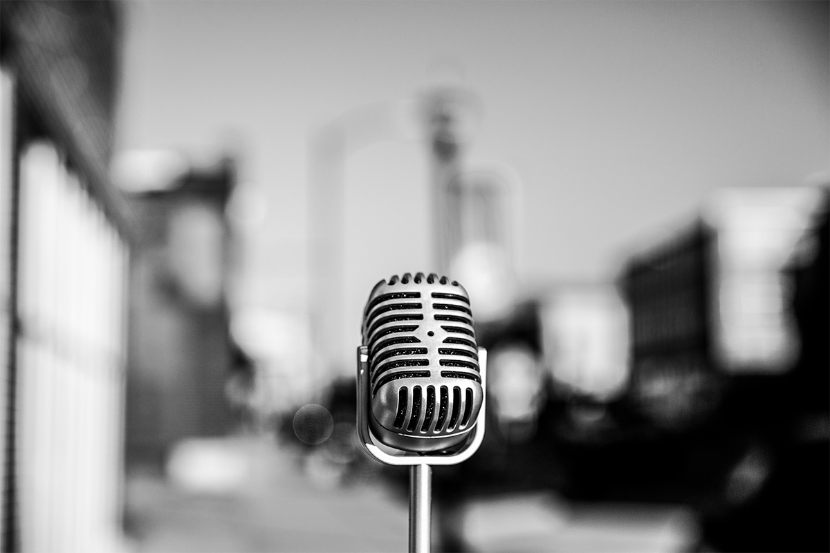 retro microphone in the middle of city