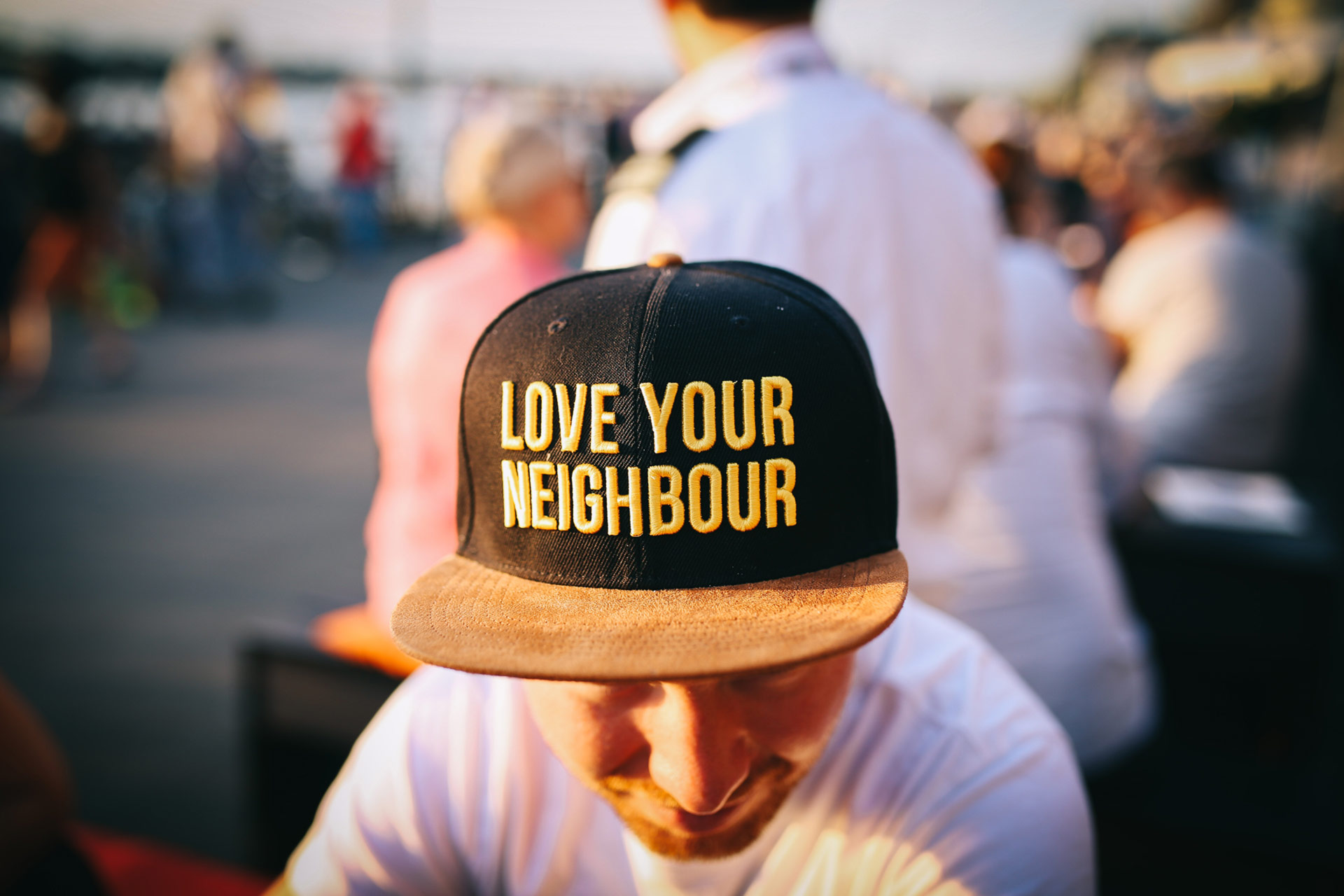 man wearing love your neighbor cap