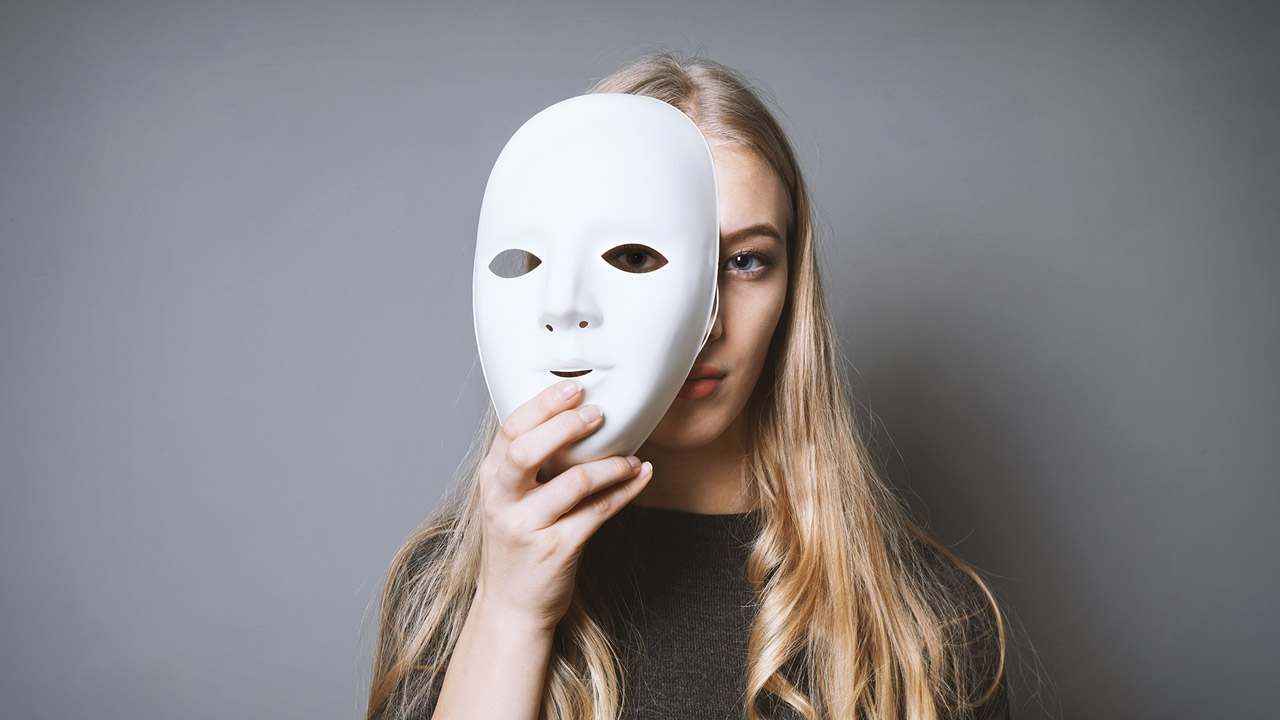 woman taking off a white mask