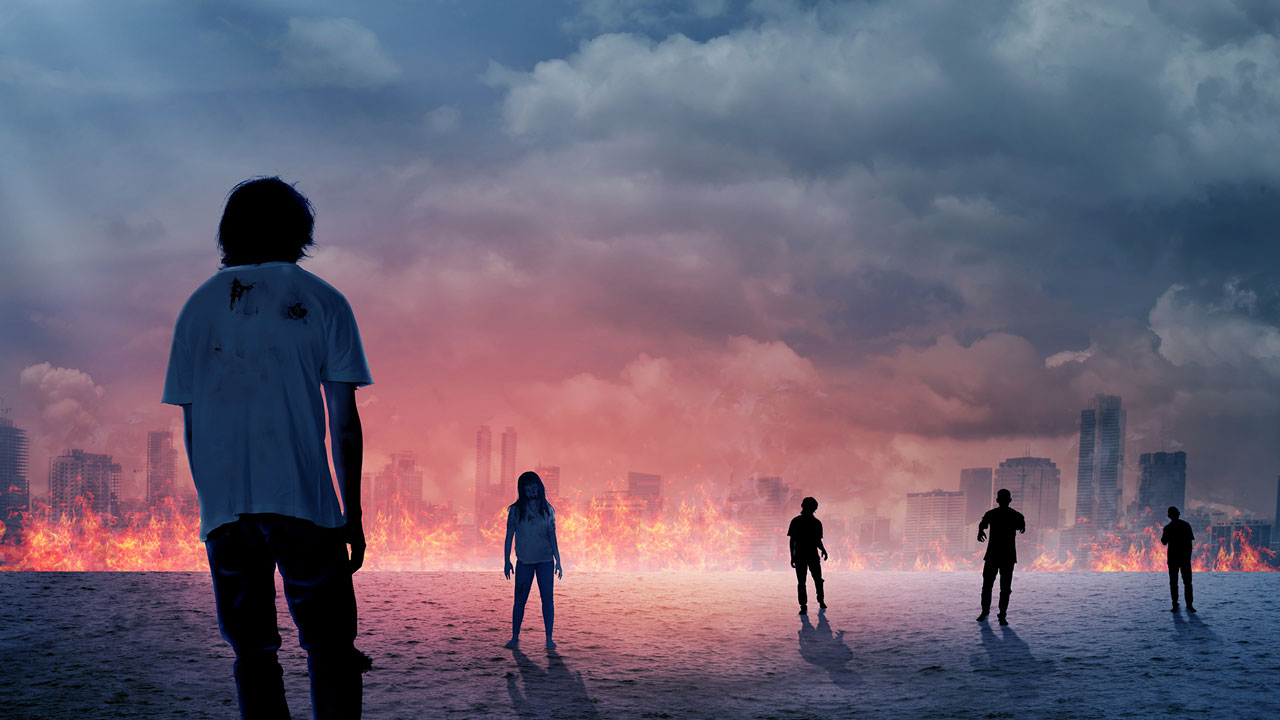 zombies walking toward burning city