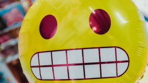 yellow-balloon-with-toxic-positivity-smiley